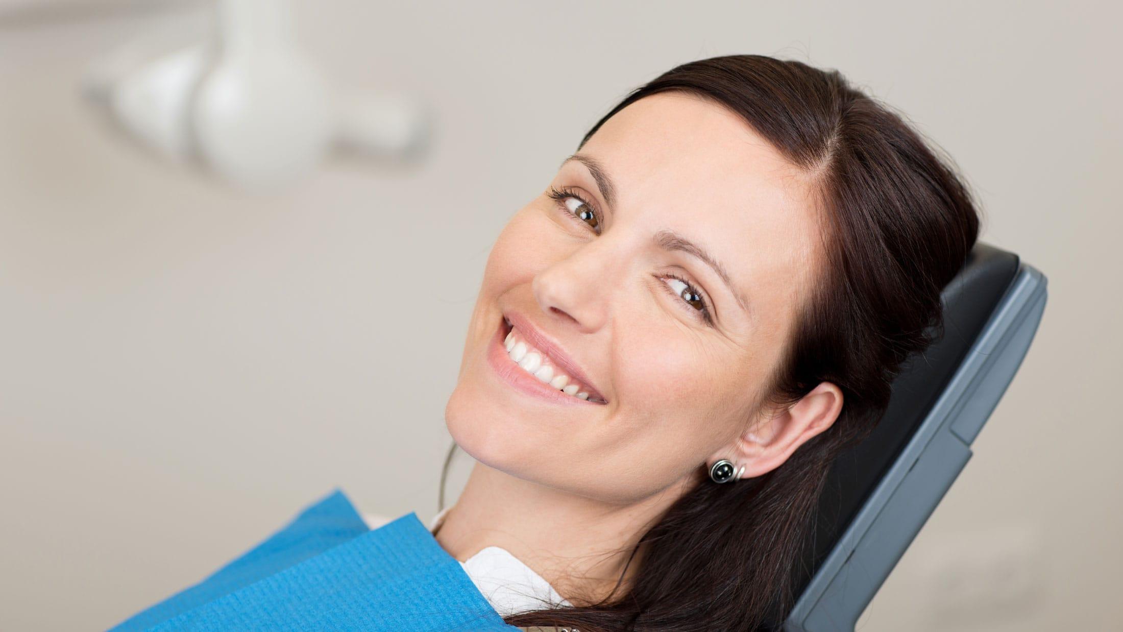 woman smile at Winnipeg dental exam