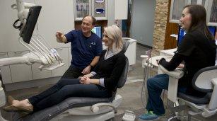woman getting a dental exam in Winnipeg